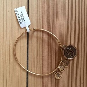 "NWT gold Alex & Ani bangle with ""G"" tag"